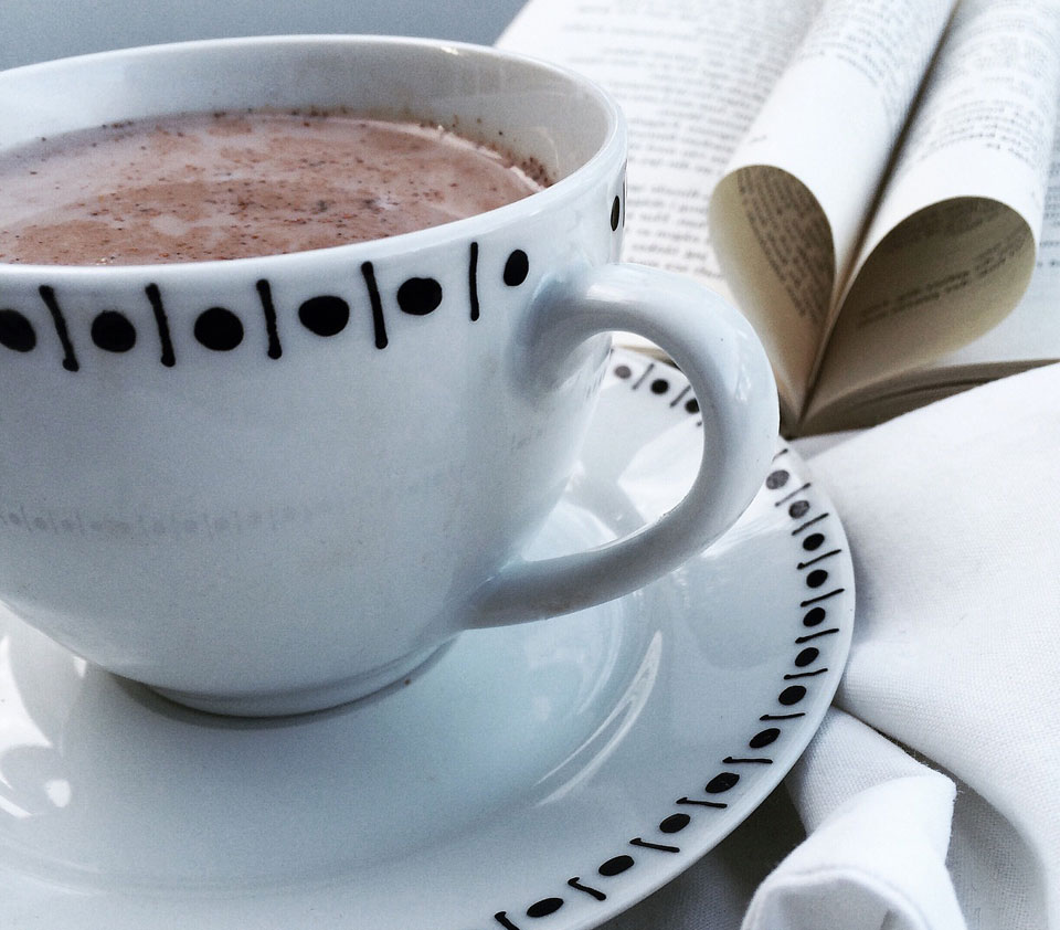 Bribe Sink Web Design with hot chocolate - image of coffee cup with hot cocoa in it